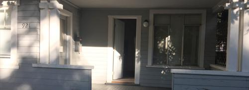 Front of the house shows a large porch with steps