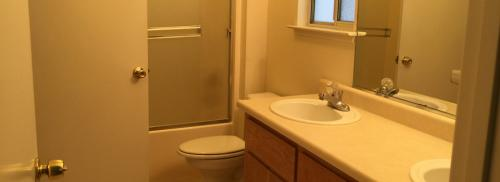 picture of bathroom with two sinks.