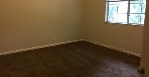 Bedroom with dark brown carpet